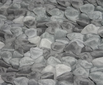 close up of a Dreamweavers Silver Grey Chamois Pebble Rug