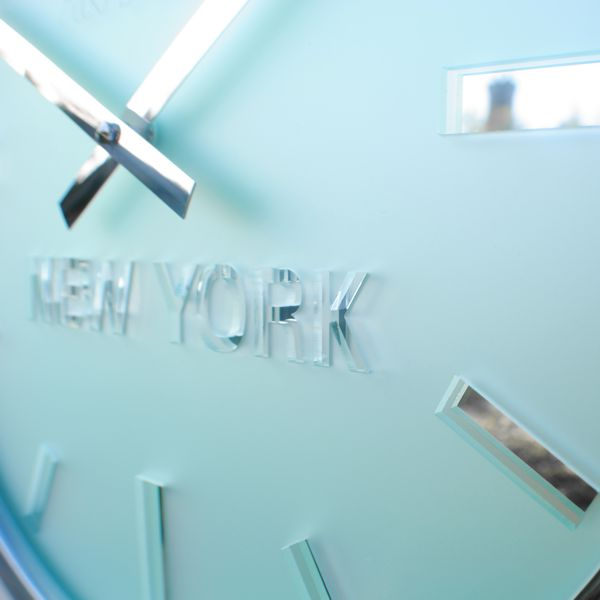 frosted timezone clock close up